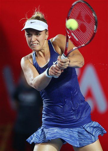 Sabine Lisicki of Germany returns a shot during the quarter-finals match against Zheng Saisai of China at the Hong Kong Tennis Open Friday, Sept. 12, 2014. (AP Photo/Kin Cheung) ▼12Sep2014AP|Lisicki through to Hong Kong Open semifinals http://bigstory.ap.org/article/lisicki-through-hong-kong-open-semifinals