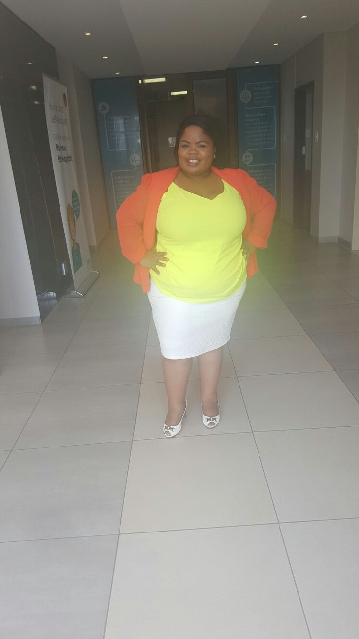 My happy colours wearing a white pleather skirt, lime top and peach jackets... styled by Molebo