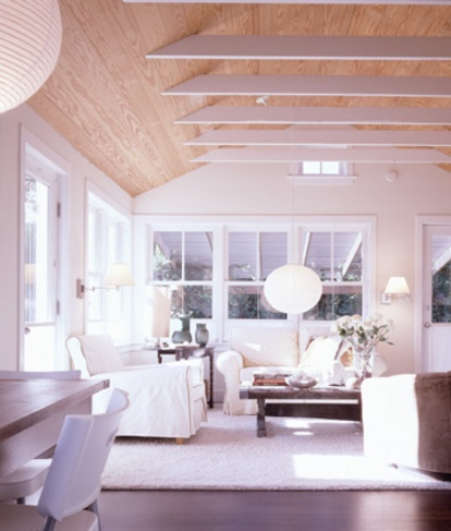 existing low ceilings were removed and clad the existing gable shape in pine shiplap.