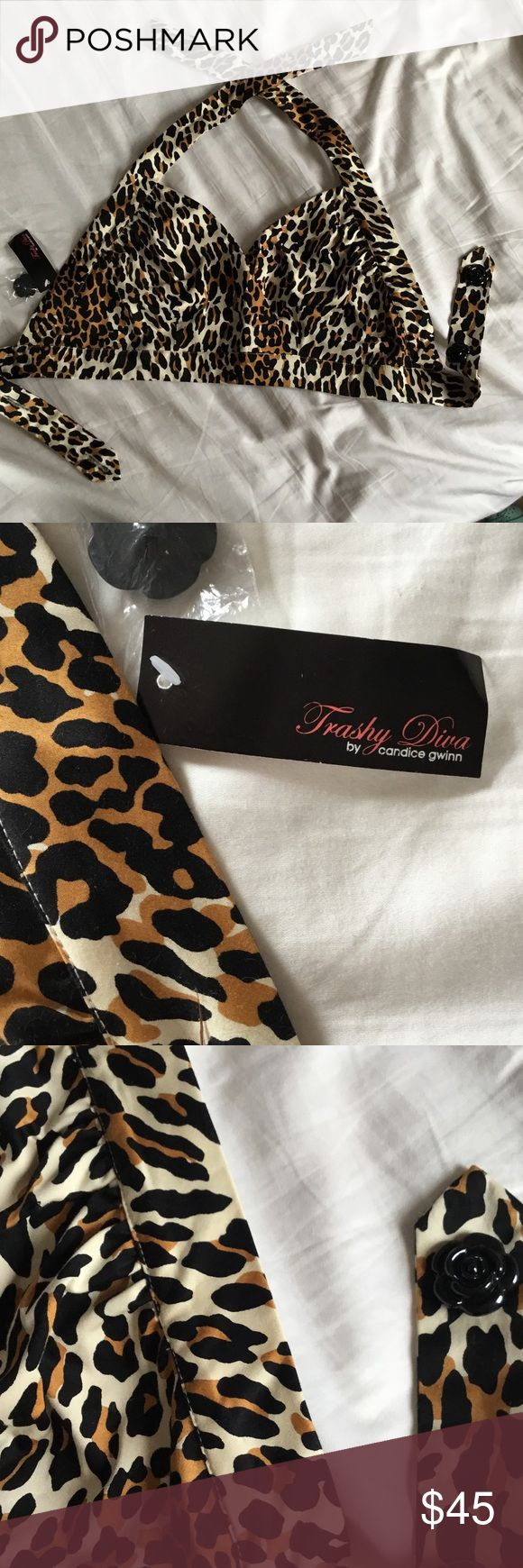 """Trashy Diva leopard beach top 12 new with tags Beautifully constructed vintage-style beach top by New Orleans boutique Trashy Diva. Leopard print cotton (97% cotton, 3% spandex), perfect for aspiring an aspiring Bettie Page. Halter top with shaped cups, underbust band has two plastic black rose buttons for extra security. Entire top is lined in more leopard fabric. Underbust strap measures 33"""", could move buttons to easily make it smaller. Trashy Diva Swim Coverups"""