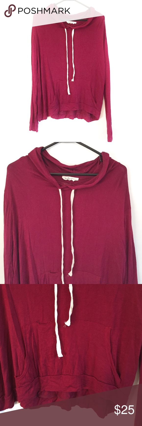 Molly Green Maroon Pullover Molly Green Maroon Pullover. It is in perfect condition except for the small hole in the pouch on the stomach (Picture four). It is a loose weight hoodie that lays on you as a casual hoodie. Not bulky, so perfect for layering. The strings can adjust the tightness of the hood.  Measurements (inches):     ~Bust: 22     ~Shoulder: 16.5     ~Length: 27  *all measurements are taken with the item laying flat*   I am always open to offers.  Bundle your likes for a…