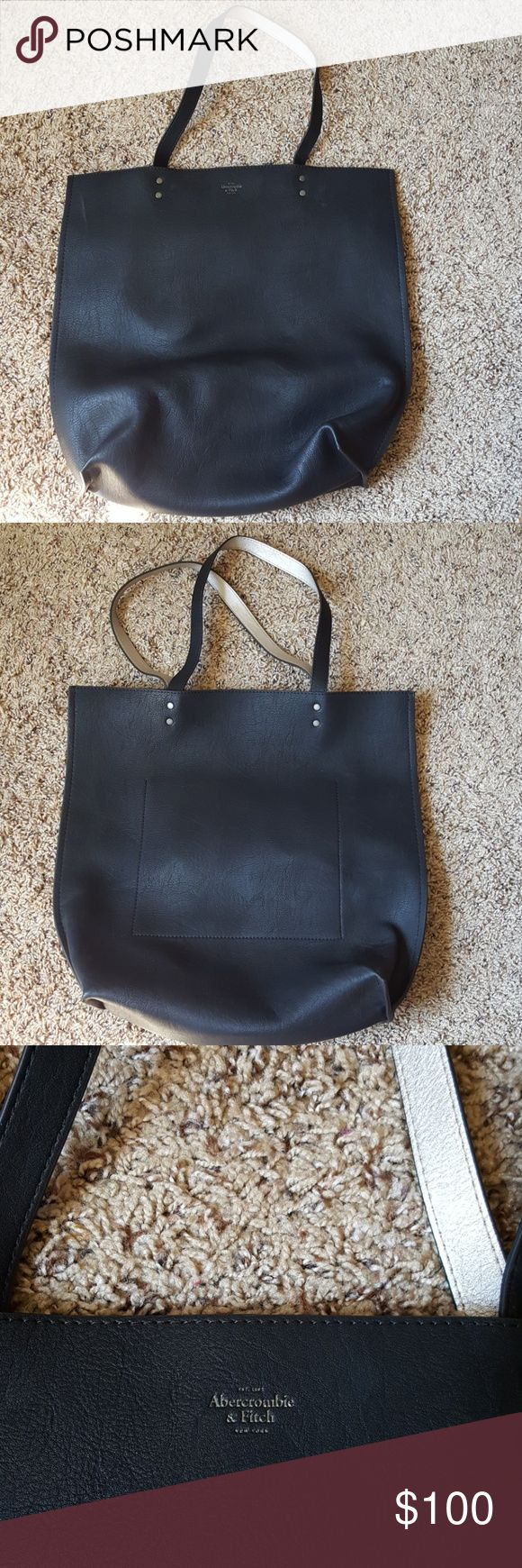 Abercrombie and Fitch pure leather reversible bag. Never used. NWOT. Black and silver reversible tote. Abercrombie & Fitch Bags Totes