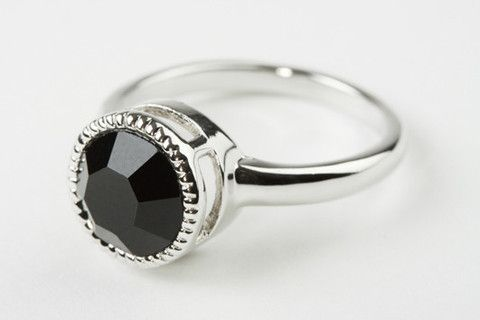 Jet Solitaire Ring: A stunning classics ring with vintage motifs becomes an irreplaceable addition to any outfit. Jet Solitaire crystal with rubover set. Real rhodium electroplated over brass.  $89.90