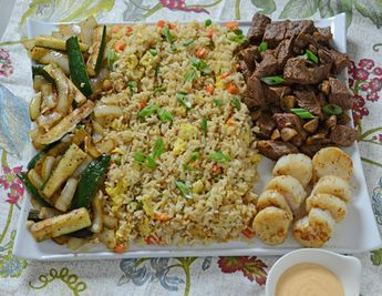 Steak and scallop teppanyaki dinner, just like the Japanese steakhouses make.  Can be done on a flattop griddle or a home electric skillet.