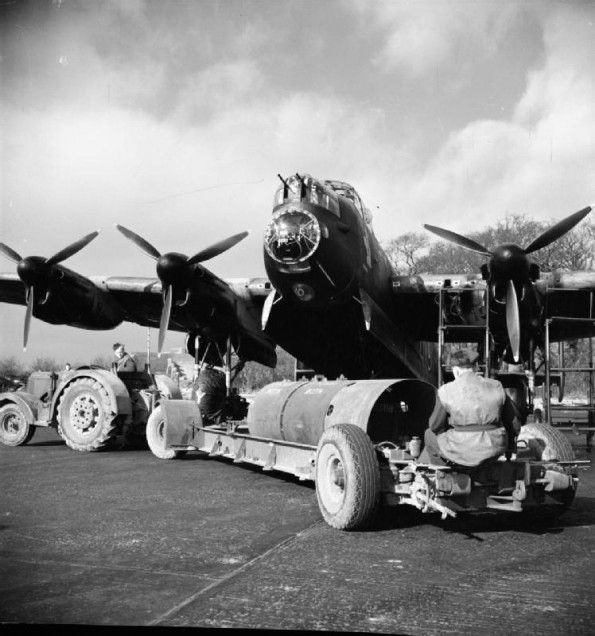 An 8,000-lb HC bomb ('super cookie') is brought by tractor to a waiting Avro Lancaster of No. 106 Squadron RAF in its dispersal at Syerston, Nottinghamshire. The target on this particular night was Stuttgart, Germany.