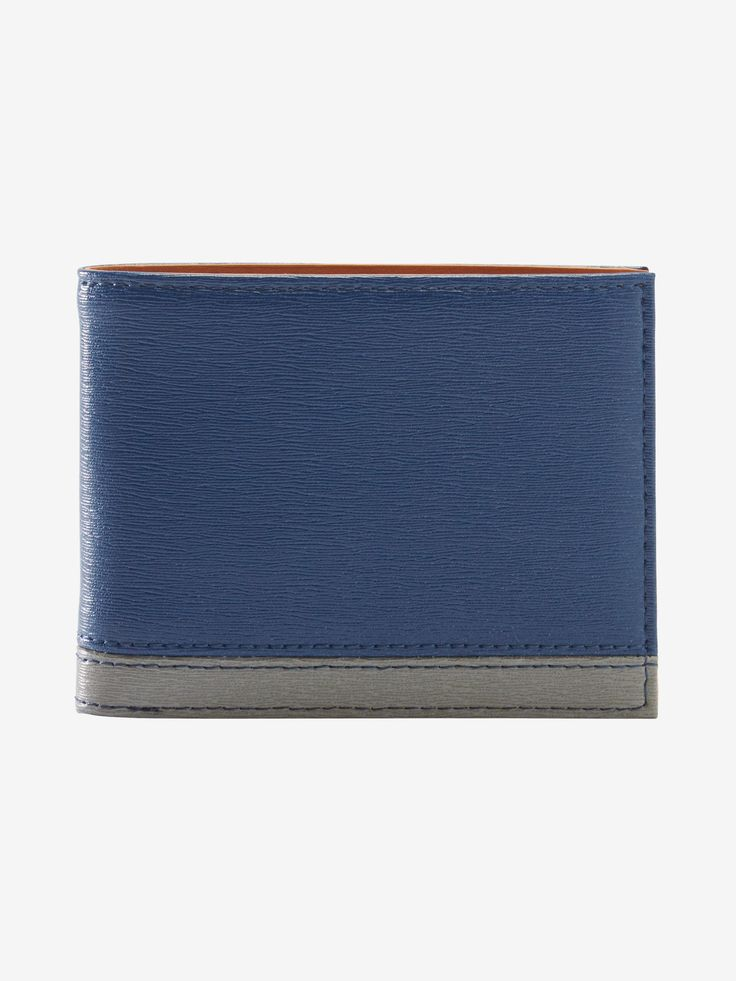 Tusk's Billfold Wallet. A timeless piece, this style is available in combinations of black, grey, indigo, and violet, so you can choose a neutral combination or opt for a bold pop of color. With a subtle bark print texture, it brings interest and detail to an everyday necessity.