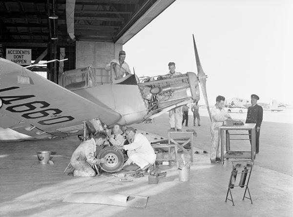 Ground crew servicing a Fairchild Cornell I aircraft, No. 19 Elementary Flying Training School, RCAF, Virden, Manitoba... / L'équipe au sol entretient un aéronef Fairchild Cornell I de la 19e École élémentaire de pilotage de l'ARC à Virden (Manitoba)... | by BiblioArchives / LibraryArchives
