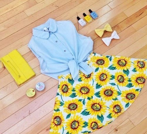 Gorgeous sunflower printed skirt with top sky blue blouse and yellow leather clutch and nails polish the best summer teenage fashion