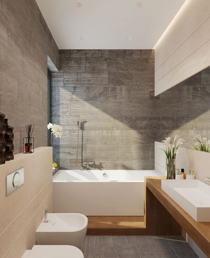 Soft grey stone tiles, continuous timber vanity/bath base and contemporary white bathroom