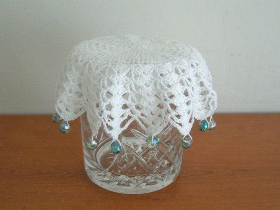 Crochet milk jug cover, glass cover, pims jug cover, or use as a doily. Edged with aqua glass beads. Handmade.