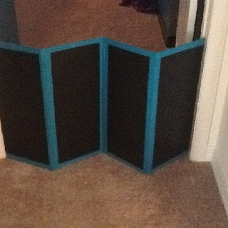 """DIY Dog Gate. Take 4 pieces of wood, some paint and Duct tape. Paint the wood, place wood 1/2"""" apart and tape seams, tape top and bottom!  Super quick and easy...and I thought of it all on my own...maybe help from Mom!"""