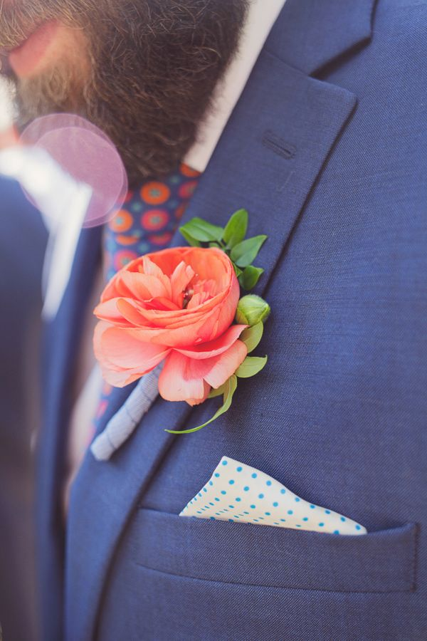 blue suite with coral floral boutonniere - photo by Maria Mack Photography