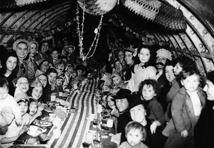 'London children enjoy themselves at a Christmas Party, on December 25, 1940, in an underground shelter.'