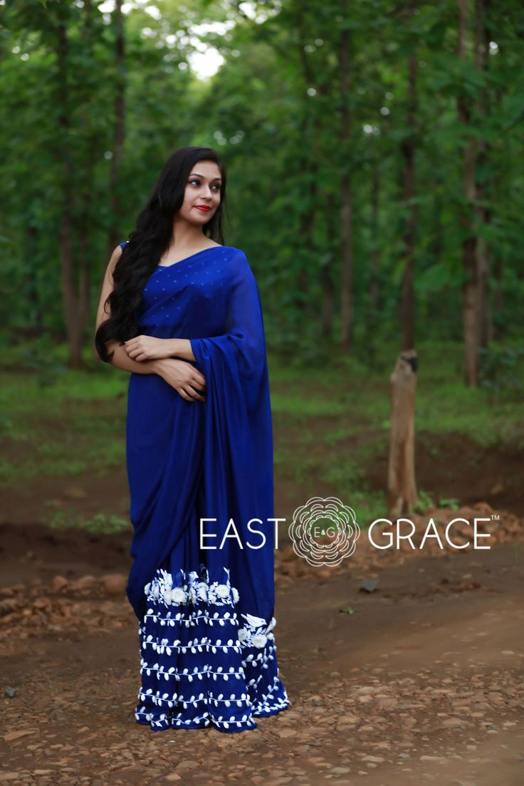 9 Pins  Featuring a rich navy blue pure silk chiffon saree with organza flowers and silken white birdies and beautiful vines with ribbonwork white leaves along the bottom. Here's a saree to invoke that feminine mystique in you. PRICE: INR 18,232.00; USD 268.12 To buy click here: https://www.eastandgrace.com/products/white-blue-birdies For help reach us at care@eastandgrace.com. With love www.eastandgrace.com