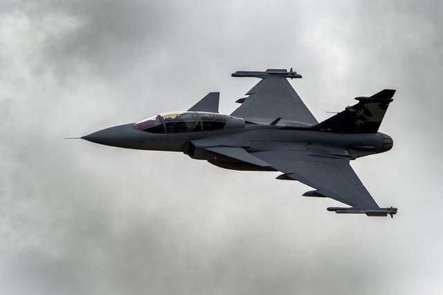 A Swedish manufacturer Saab's Gripen F fighter jet flies during a 2012 flight demonstration of the Swiss Air Force over Axalp in the Bernese Oberland. The Czech government on Wednesday renewed its lease on 14 Swedish fighter jets until 2027. (Fabrice Coffrini / AFP/Getty Images)