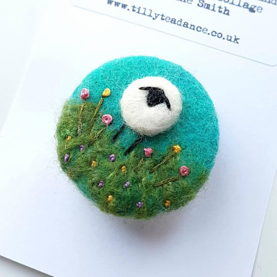 Felted & embroidered sheep brooch by Textile Artist Maxine Smith of Tilly Tea Dance  https://www.etsy.com/uk/listing/497286339/handcrafted-wool-brooch-with-needle