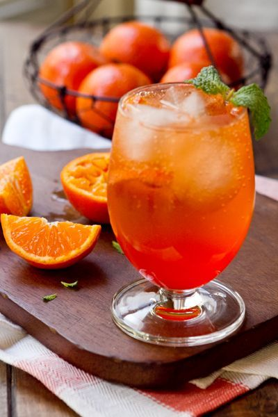 A classic  Aperol Spritz cocktail jazzed up with a little fresh tangerine juice!