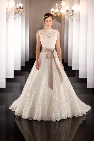 For the bride who wants a little more coverage on her wedding day-- how about this stunning Martina Liana gown? {Bella Bridal Gallery}