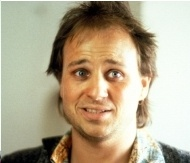 """Robert Francis """"Bobcat"""" Goldthwait (born May 26, 1962) is an American actor, comedian, screenwriter, and film and television director. He is commonly known for his energetic stage personality, his dark, acerbic black comedy, and his gruff but high-pitched voice."""
