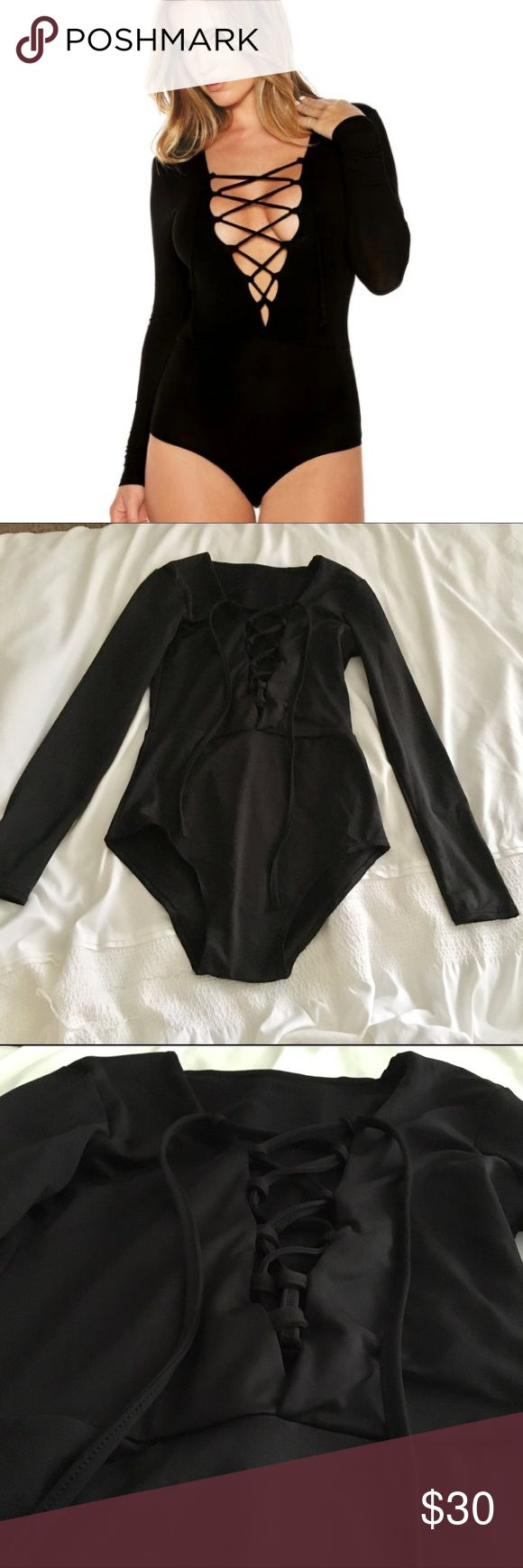 Crisscross long sleeve v-neck bodysuit Super trendy style right now! Brand new / never worn / NWT. High quality fabric and very flattering when on. Not topshop / here for views. Make me an offer! Topshop Tops Tees - Long Sleeve