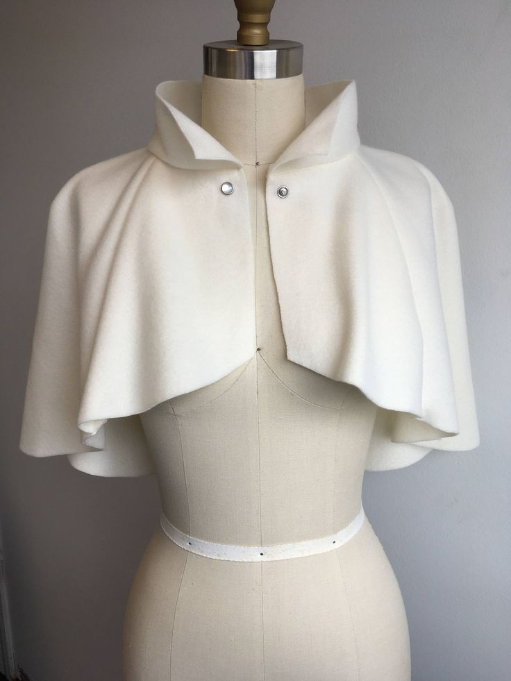 A personal favorite from my Etsy shop https://www.etsy.com/listing/510675544/ivory-fleece-cutaway-capelet-medium