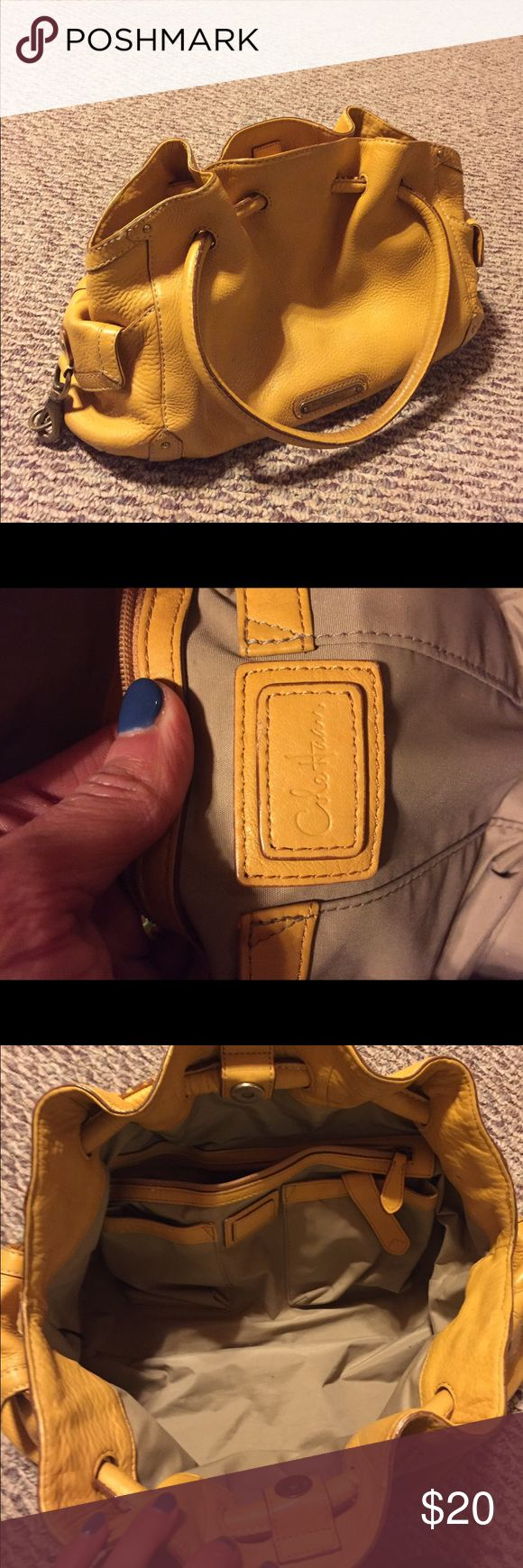 Designer Cole Haan mustard yellow purse! This designer Cole Haan mustard yellow satchel/shoulder purse is timeless. Good condition but the bottom could use some cleaning (pictured). Priced to sell Cole Haan Bags Shoulder Bags