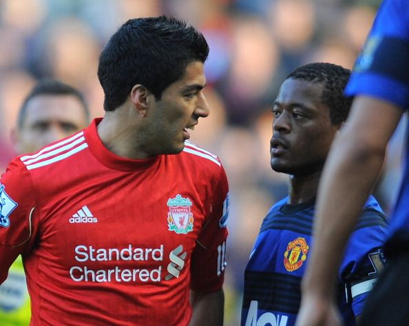 Liverpool's Uruguayan forward Luis Suárez (L) exchanges words with Manchester United's French defender Patrice Evra during the English Premier League football match between Liverpool and Manchester United at Anfield in Liverpool, north-west England, on October 15 2011