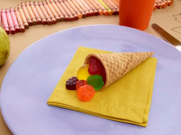 Candy Cornucopia : For dessert, kids can treat themselves to an ice cream cone cornucopia filled with gummy fruits.  Kids' Table Designs and Styling by Ara Farnam