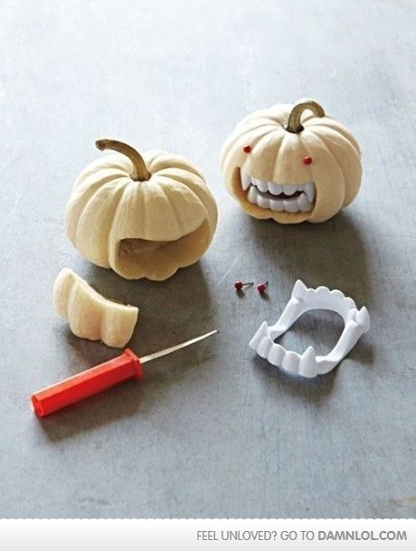 Cute Halloween pumpkin idea! Using vampire teeth on mini pumpkin!