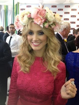 What was Delta thinking, did a bouquet fall on her head. The colours don't even relate to her outfit.Celebrity snapshots from Melbourne Cup