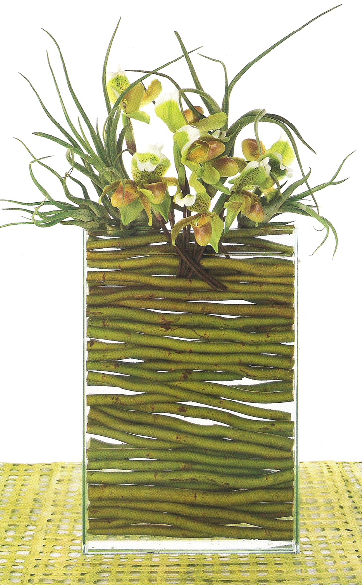 cut willow branches as vase filler for contemporary flower vase