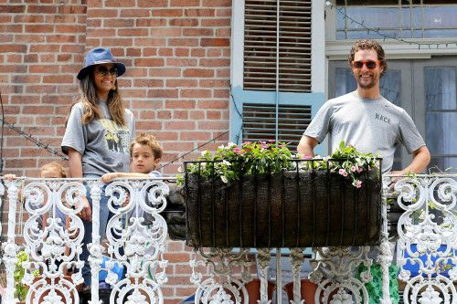 Matthew McConaughey and Camila Alves hang out on their balcony with their kids Levi and Vida on May 17, 2014