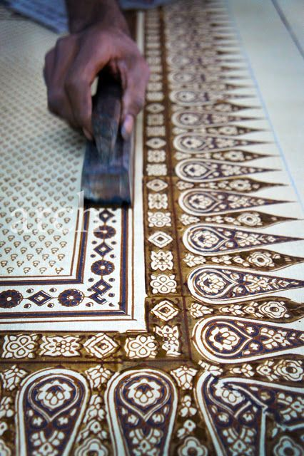 Ajarakh uses the process of resist printing in which hand block printing is done on designated areas in the pattern which are pre-treated to resist penetration by the dye.