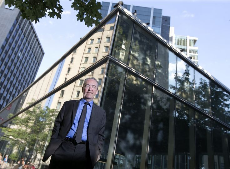 Peter Kirby, international arbitration lawyer and crime fiction writer, poses outside his offices in downtown Montreal, September 11, 2015.  (Christinne Muschi for McGill News Alumni Magazine )
