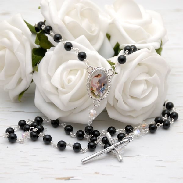 Onyx Gemstone 1st Communion Rosary for Boys & Girls - Designed especially for little hands, this handsome 1st Holy Communion rosary is crafted with 6mm onyx semi precious gemstone and clear Swarovski crystal 'Our Father' beads.  The centerpiece medal is an exquisite colour depiction of a boy or girl receiving their First Holy Communion . Finished with a slim stylish crucifix measuring 4cm by 2.1cm.