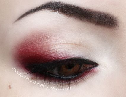 Thick black liner with a hint of red.