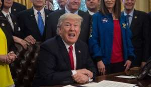 US President Donald Trump speaks before signing a bill increasing funding for NASA in the Oval Offic... - Nicholas Kamm, AFP/Getty Images