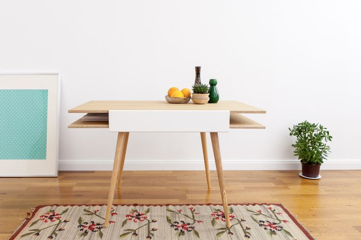 table and desk in one - you just need to slide the tops to create an additional space for your work or crafts