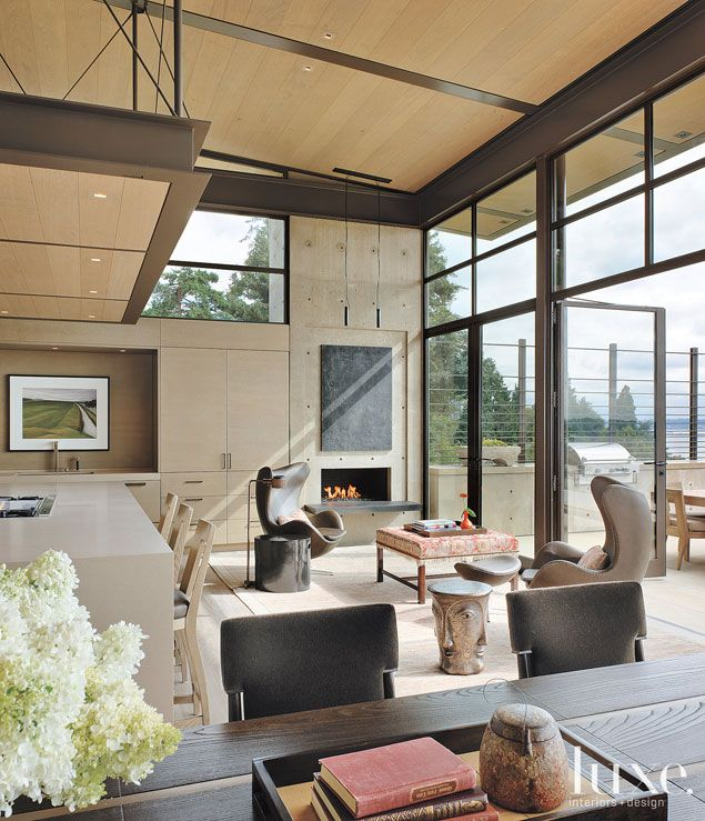 Small fireplace but cozy seating  Modern Twist: Peter Conard's Bold Design Team