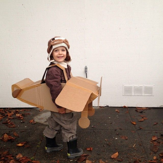 Pilot costume and homemade airplane from shipping boxes. Handmade Halloween costumes are my favorite. Made by Katrina.