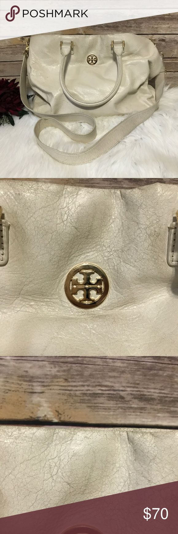 """Tory Butch Ivory Soft Leather Crossbody Purse In Good Used Condition. This bag shows signs of wear due to the thin, soft leather. It's a """"Crinkly"""" leather. Color transferred from my pants when wearing the purse on my hip. Adjustable strap. Magnetic snap closure. Interior in good condition. No holes, some light stains from normal use. Has zipper pocket and 2 slip pockets. Ask Questions! ⭐️⭐️⭐️⭐️⭐️ Star Rating 🙋🏻Top 10% Seller 🚫Trades 🚫Paypal 📦Same/Next Day Shipping ✅Bundles ✅Reasonable…"""