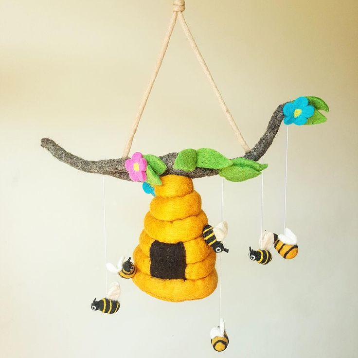 Expect a lot of sweetness from our bright bumblebees! This perky bee hive mobile hanging can be hung on the wall or the door, and is made complete with six little bumblebees. #allthingsfelt #nurserydecor #kidsroomdecor #sgkids #kidsdecor #kidsinspo #handmade #sgmoms #instakids #sgmummy #nurserymobile #mobilehanging #thatsdarling #kidsdecor #kidsinterior #kidsinteriors #kidsroom #kidsroominspo #kidstagram #kidsdesign #childrensroom #sgig #igsg #sgshopping #sgkidsstuff