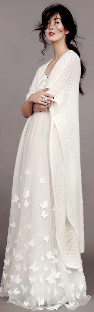 Kaviar Gauche Couture, wedding dresses: knitted kimono, tulle gown with butterflies.