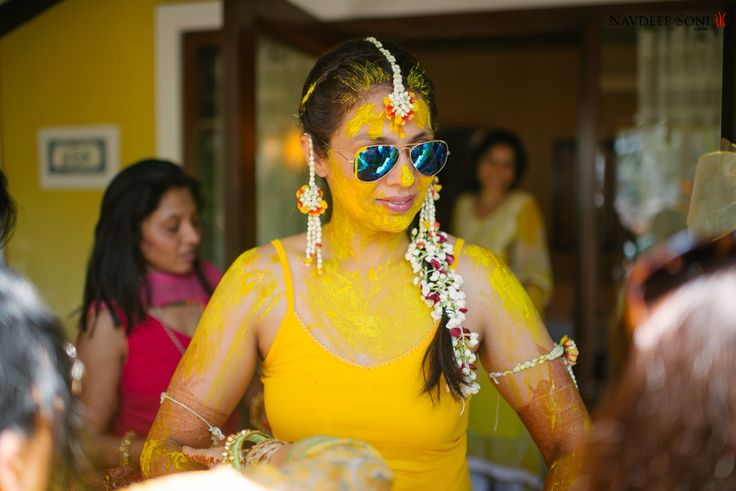 Nothing beats a bride in aviators. This stunning picture from the Haldi ceremony is our favourite.
