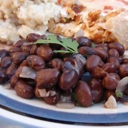 Simple way to spice up Black Beans.....  In a saucepan combine 1 can black beans, 1 small onion, and 1 clove garlic, and bring to a boil. Reduce heat to medium-low. Season with 1 tbsp chopped fresh cilantro, 1/4 tsp cayenne, and salt to taste. Simmer for 5 minutes, and serve.