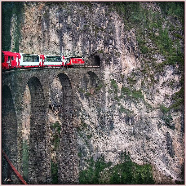 The Landwasser viaduct is a swiss railway over crossing on the Glacier-Express route. The viaduct is located in grisons and it belongs to the UNESCO World Heritage since 2008. The Glacier-Express is a panorama train, running from Zermatt to St. Moritz !