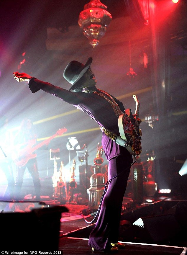 Impressive: Prince showed off his flexible back while playing his guitar at the Hollywood Palladium on Saturday night