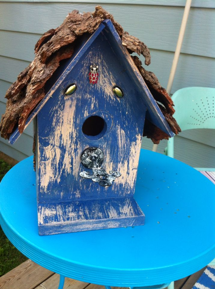 Chic birdhouse... My daddy built it and I designed it. I love the how it turned out I didn't want to give it back