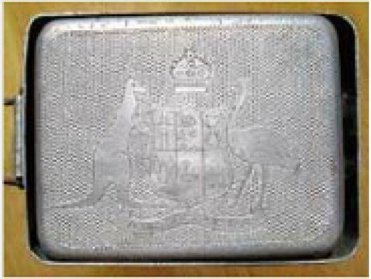 Top of 'dixie'  mess tin displaying Australian coat of arms