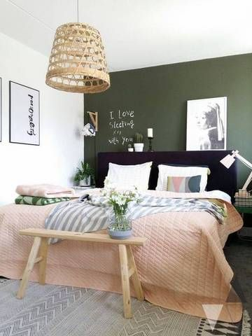 Green chalkboard accent wall, pink bed, diy light bedroom, upholstered headboard, black blush green room